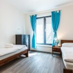 Pokoj se dvěma jednolůžky apartmánu Adina 2